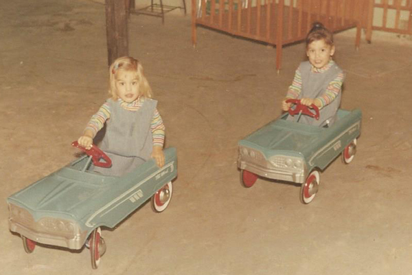From left to right: Candy Webb Henderson, Connie Webb Mitchell scooting around in our new blue cars